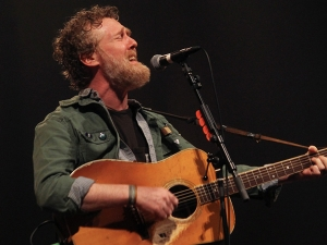 Glen Hansard singing on stage