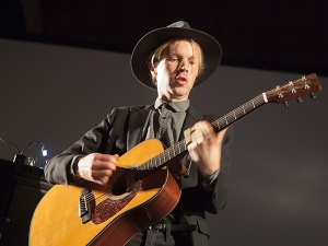 Beck performing on stage