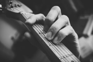 Fingers doing a barre chord